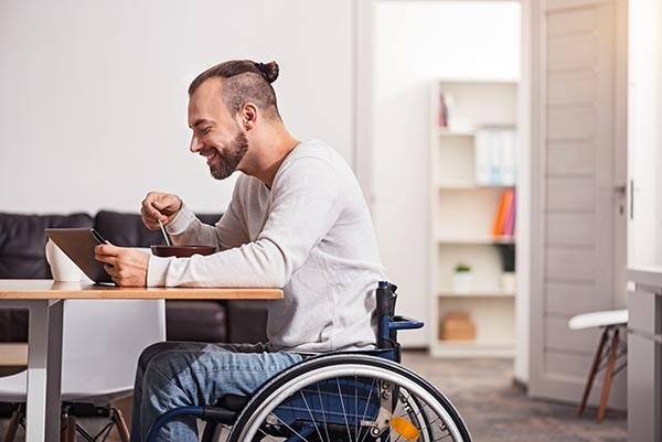 Accessibility - tablet being used by man in wheelchair
